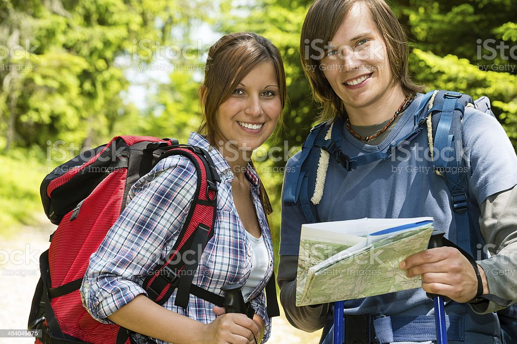 Portrait of trekking couple checking the map royalty-free stock photo