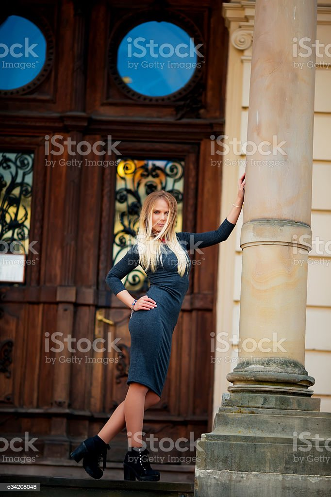 Portrait of Trendy Hipster Girl Standing at the royalty-free stock photo