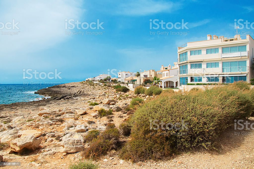 Portrait of tropical apartment building on the beach. stock photo