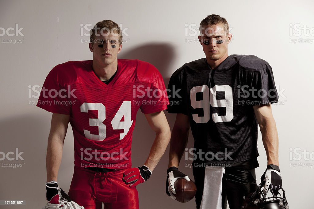 Portrait of two American football players stock photo
