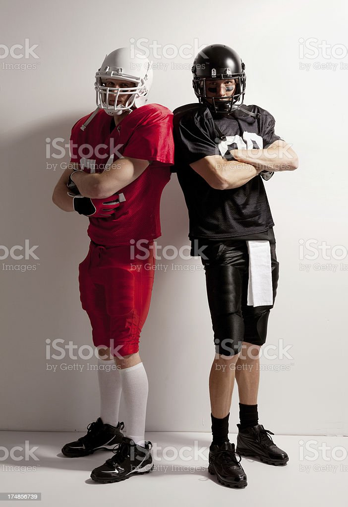 Portrait of two American football players royalty-free stock photo