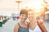 Portrait of two beautiful women in Coney Island at sunset