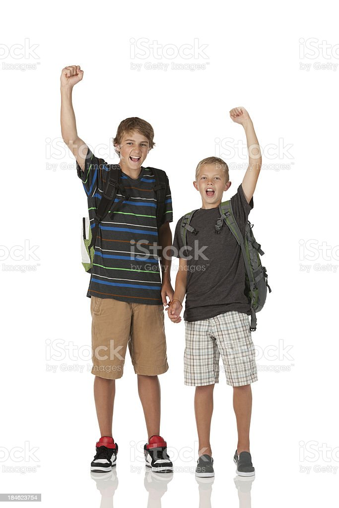 Portrait of two boys cheering royalty-free stock photo