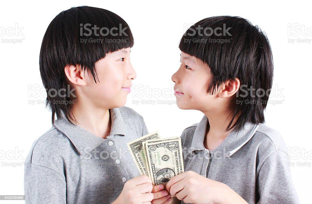 Portrait of two boys, twins holding money Lizenzfreies stock-foto