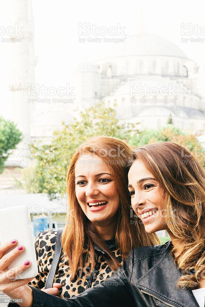 Portrait Of Two Cheerful Women Taking Selfies In Istanbul stock photo