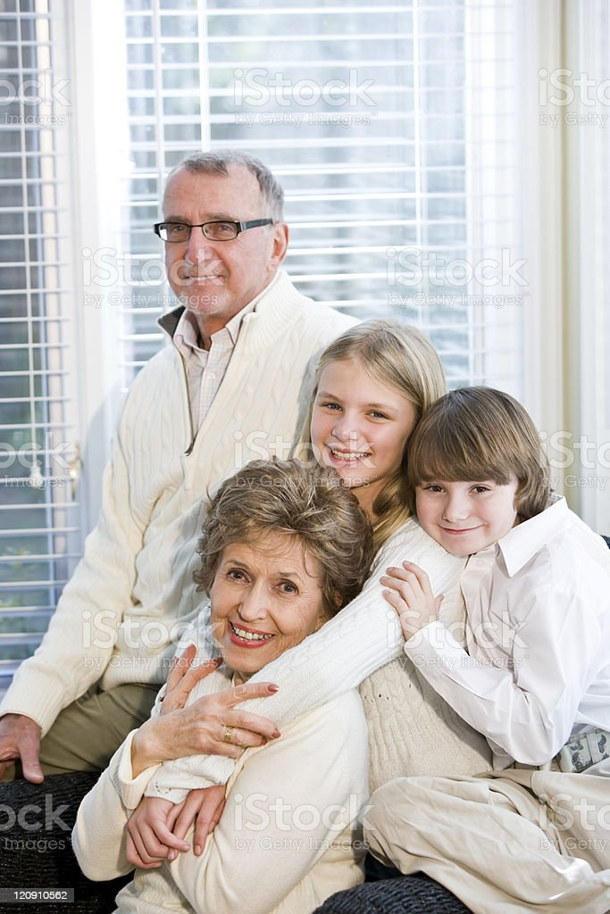 Portrait of two children with grandparents royalty-free stock photo