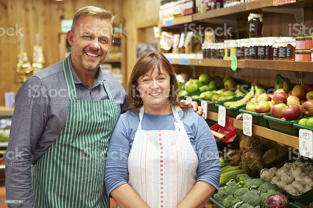 Portrait of two co-workers at farm shop stock photo