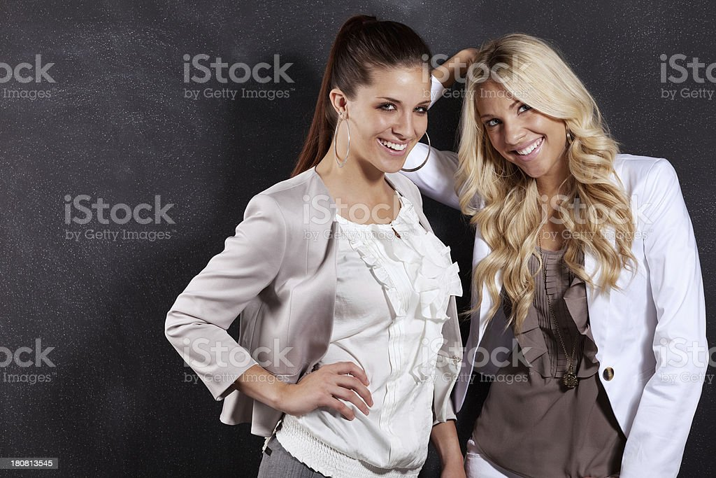 Portrait of two female friends smiling stock photo