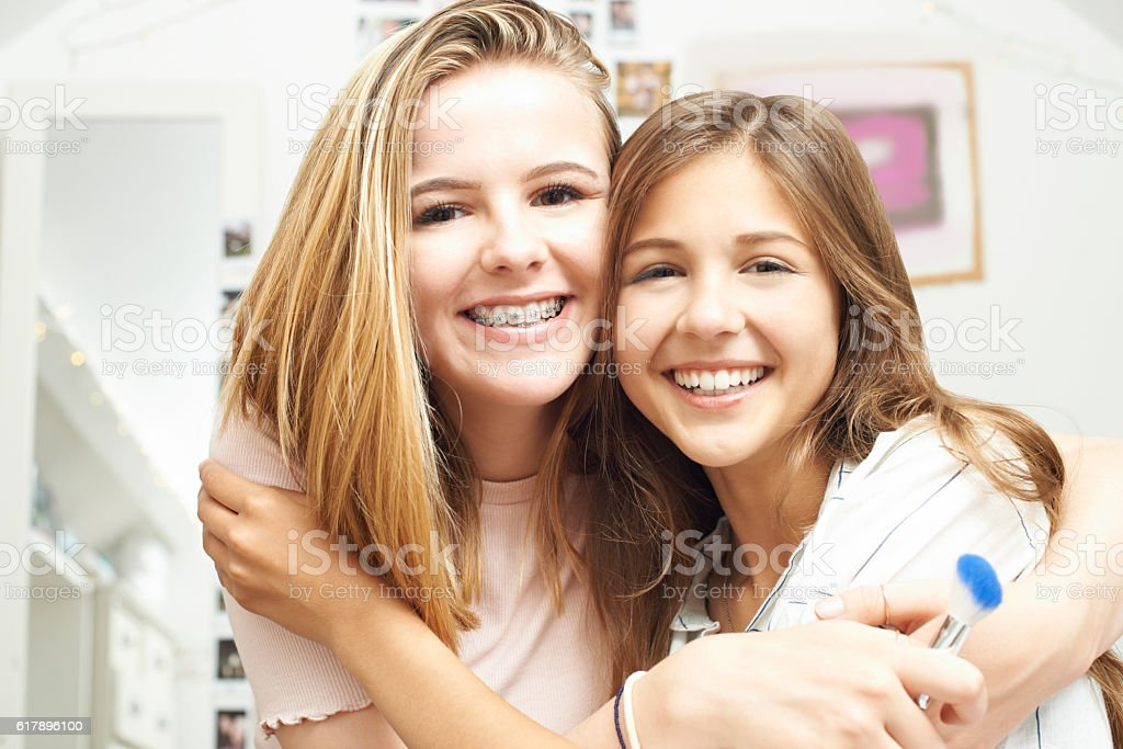 Portrait Of Two Female Teenage Friends In Bedroom stock photo