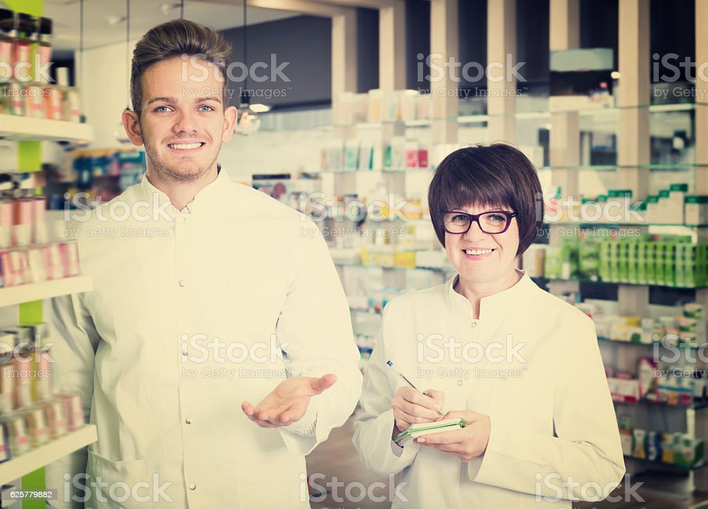 Portrait of two friendly adult pharmacists stock photo