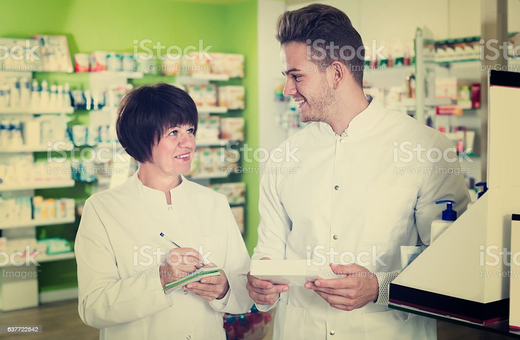 Portrait of two friendly pharmacists stock photo
