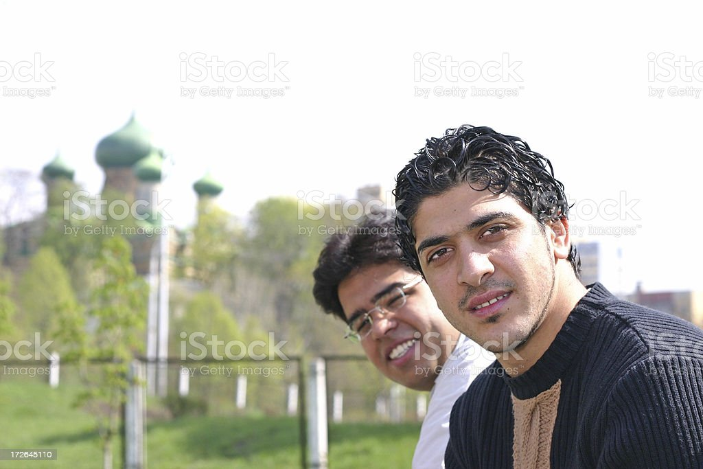 Portrait of Two Friends with Landmark in Background royalty-free stock photo