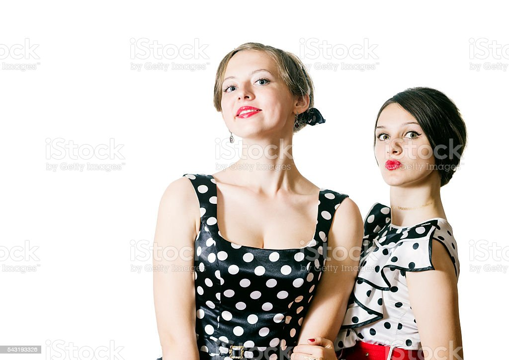 Portrait of two girls in pin-up style stock photo