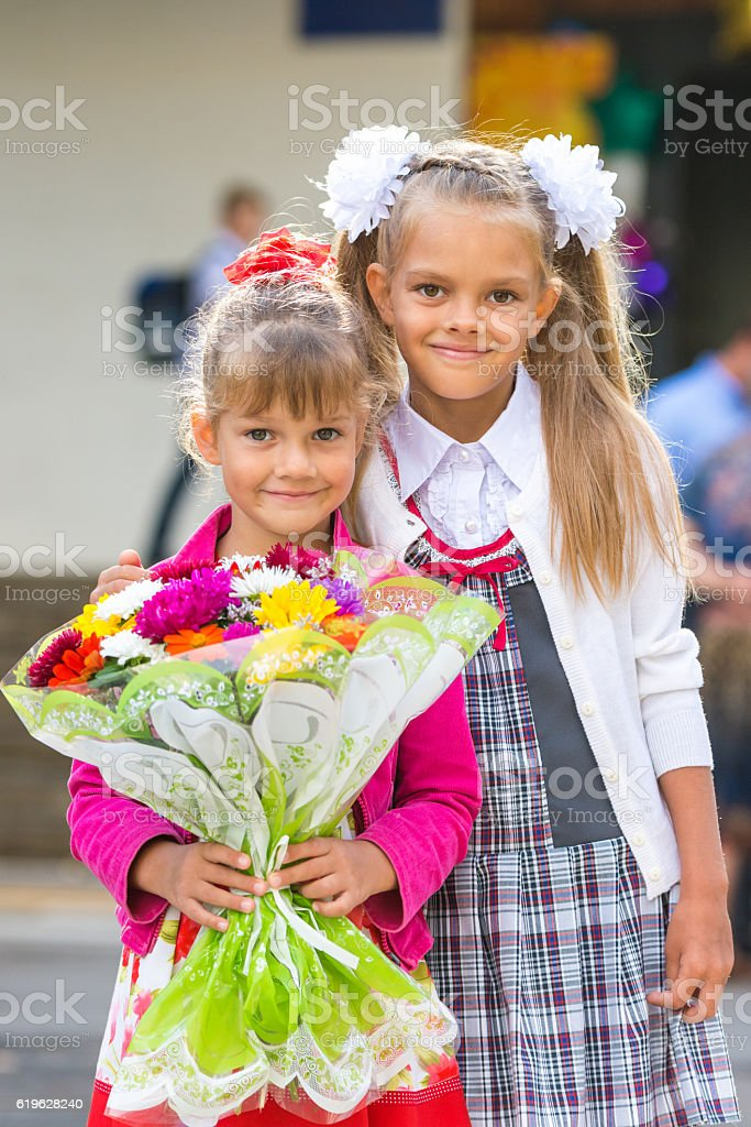 Portrait of two girls in school September 1 stock photo