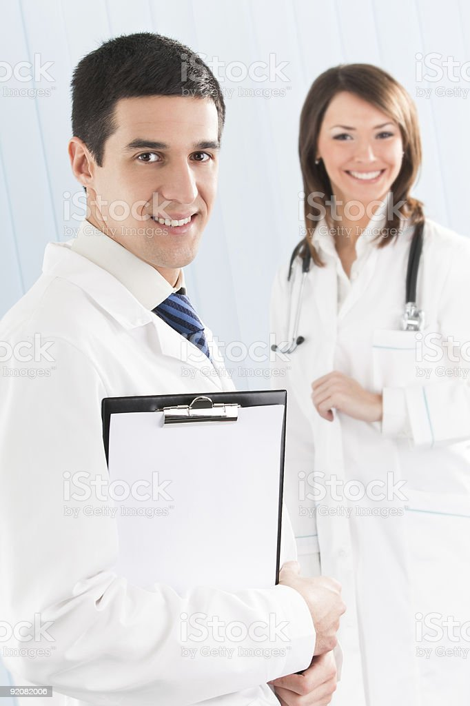 Portrait of two happy smiling medical people at office royalty-free stock photo