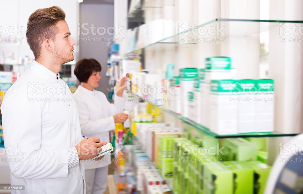 Portrait of two laughing adult pharmacists stock photo