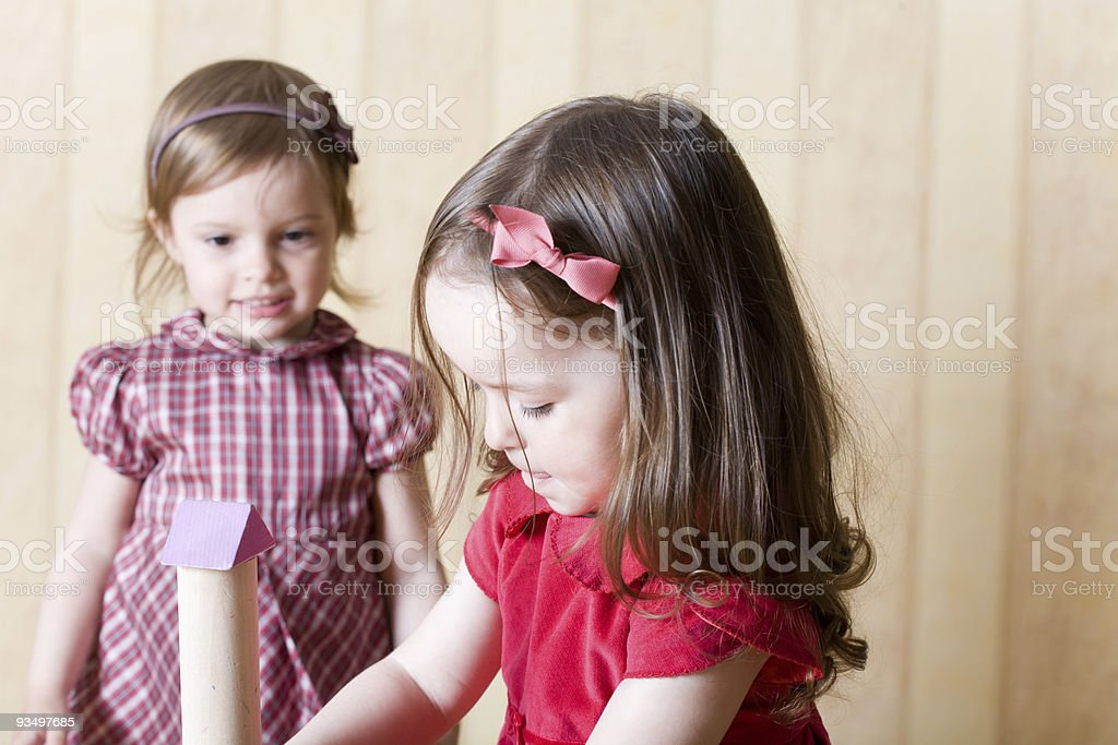 Portrait of two little girls building toy tower royalty-free stock photo