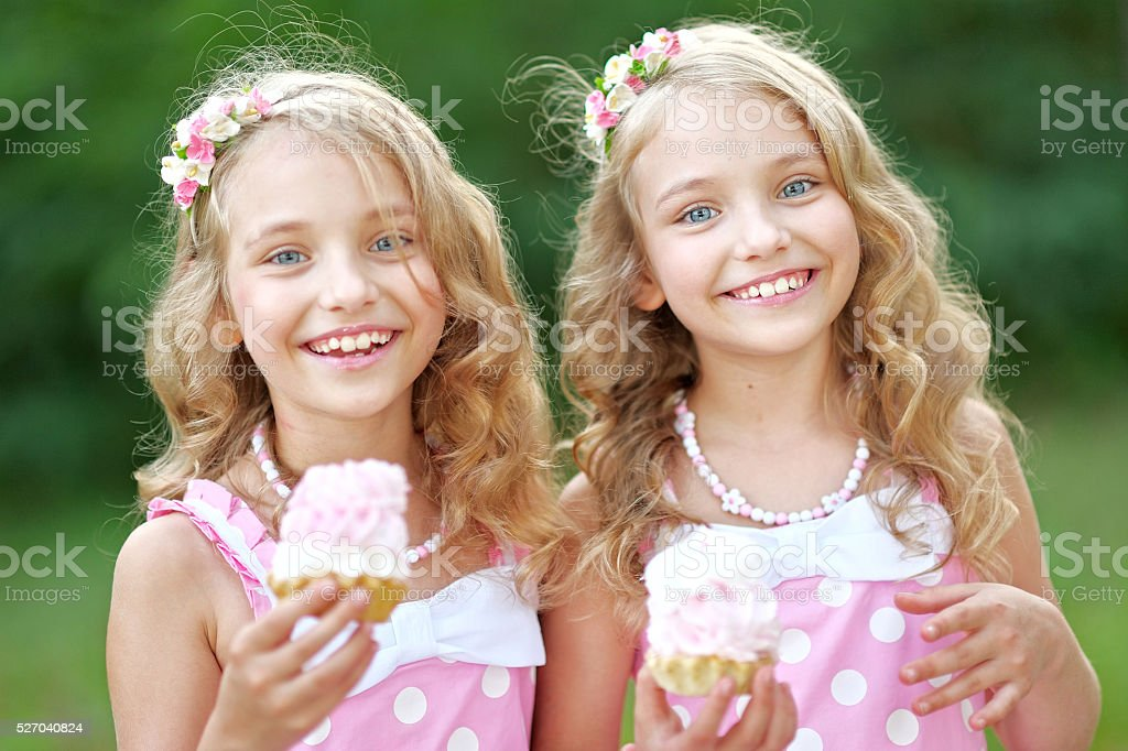 Portrait of two little girls twins stock photo