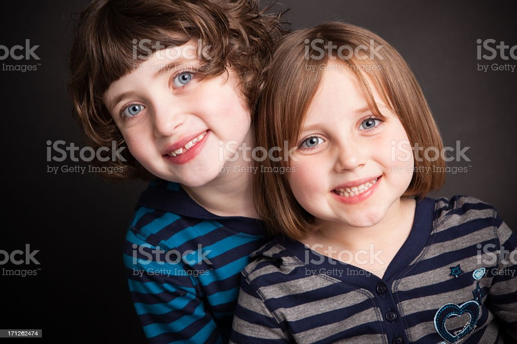 Portrait of Two Little Sisters, With Black Background royalty-free stock photo