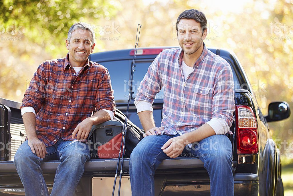 Portrait Of Two Men Pick Up Truck On Camping Holiday stock photo
