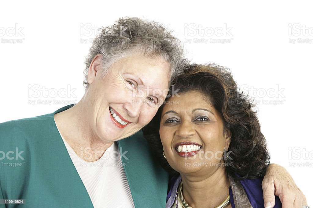 Portrait of two middle aged women of different ethnicity stock photo
