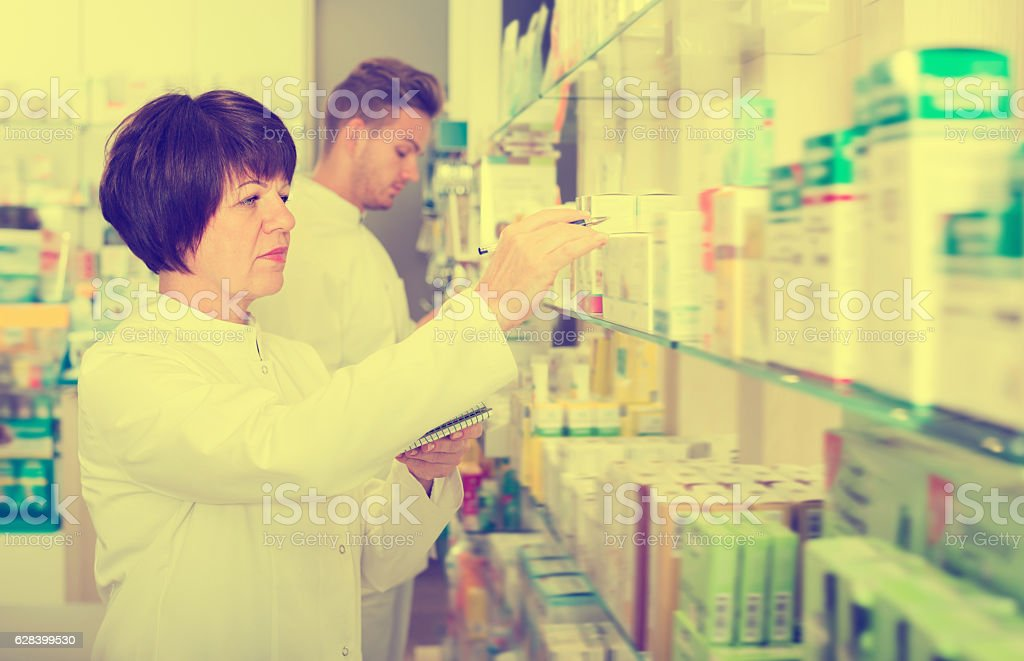 Portrait of two ordinary pharmacists stock photo