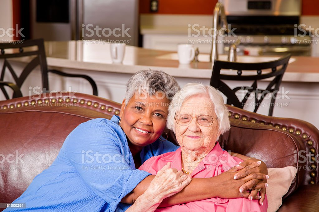 Portrait of two senior adult women friends. Assisted living. stock photo