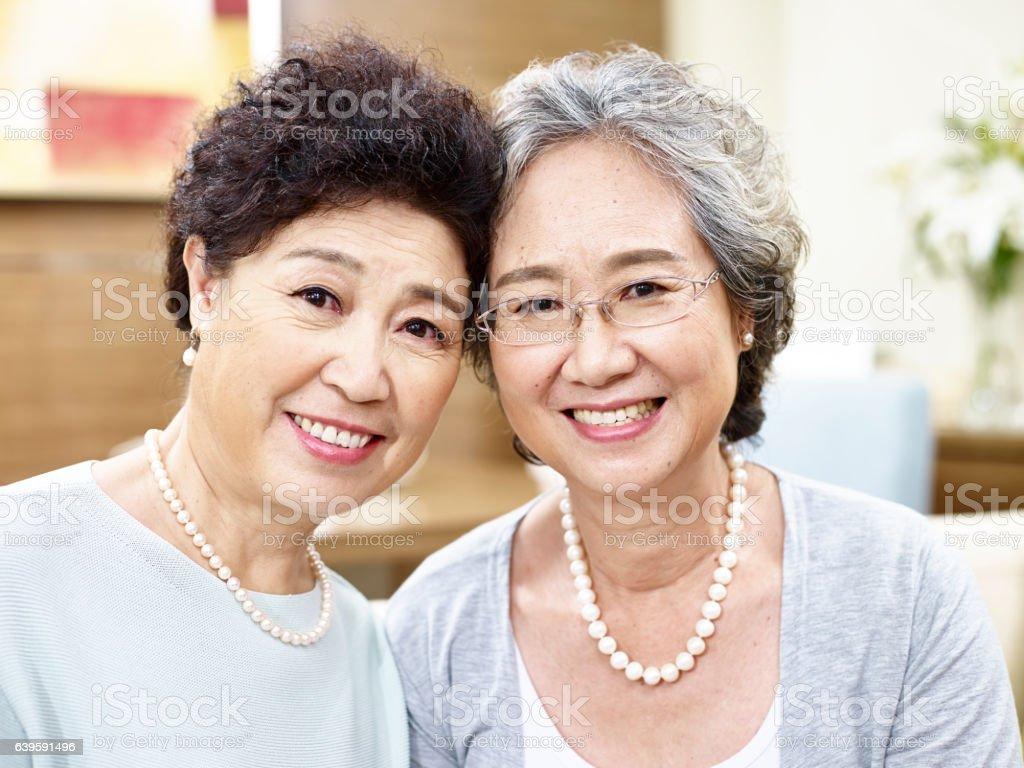 portrait of two senior asian women stock photo