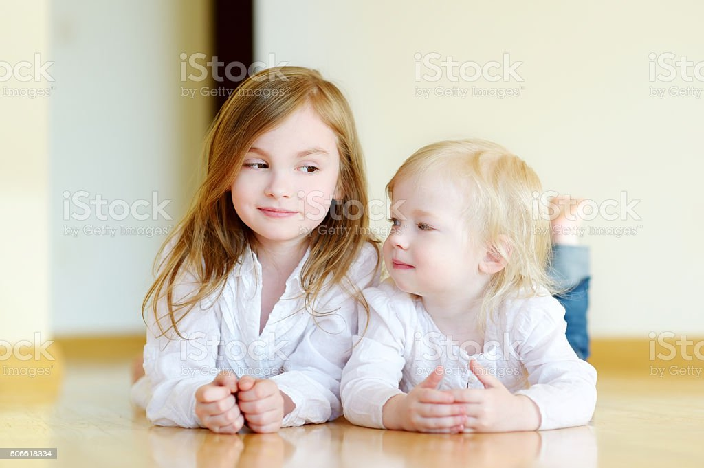 Portrait of two sisters at home stock photo
