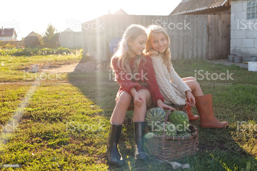 portrait of two sisters during the autumn harvest royalty-free stock photo