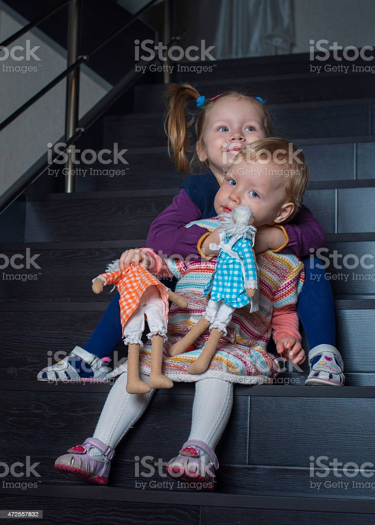 Portrait of two sisters on the  stairs royalty-free stock photo