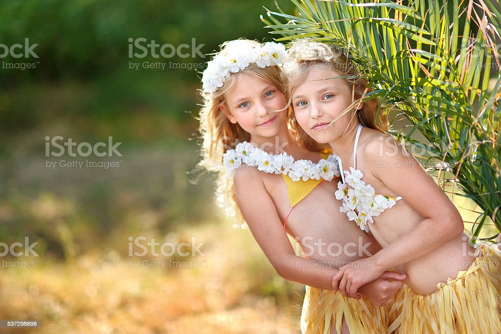 portrait of two sisters twins in tropical style stock photo