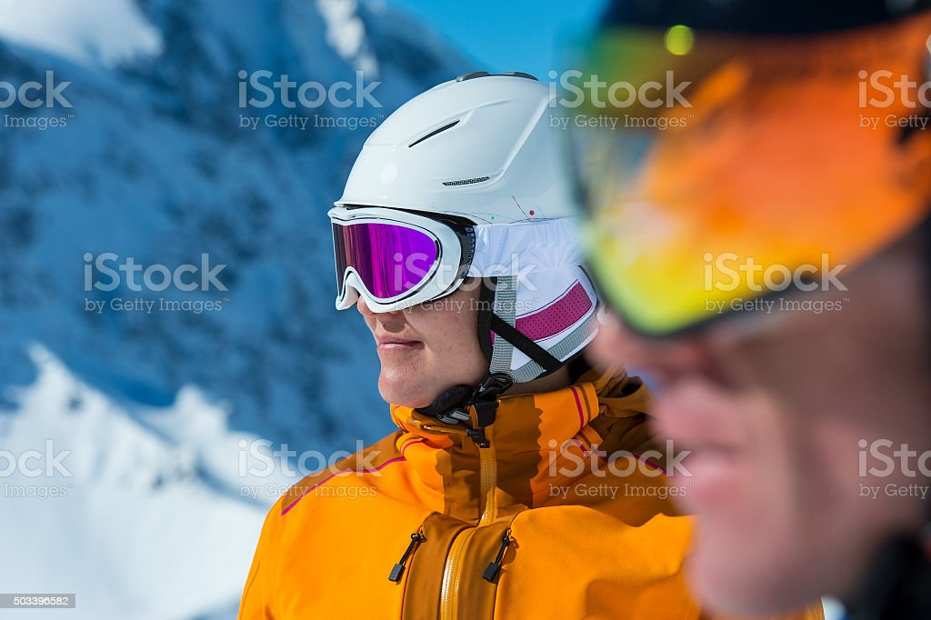 portrait of two skier or snowboarder and blurred stock photo