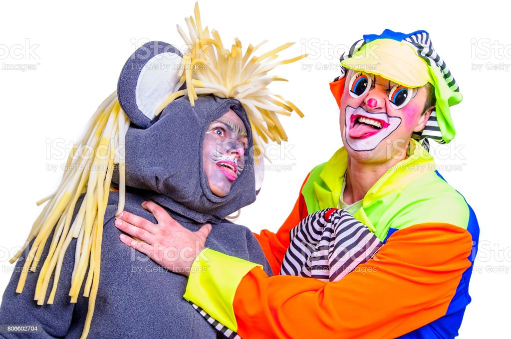 Portrait of two smiling and fooling around animators in theater role - grey mouse and clown. Emotional and colorful. Isolated background stock photo