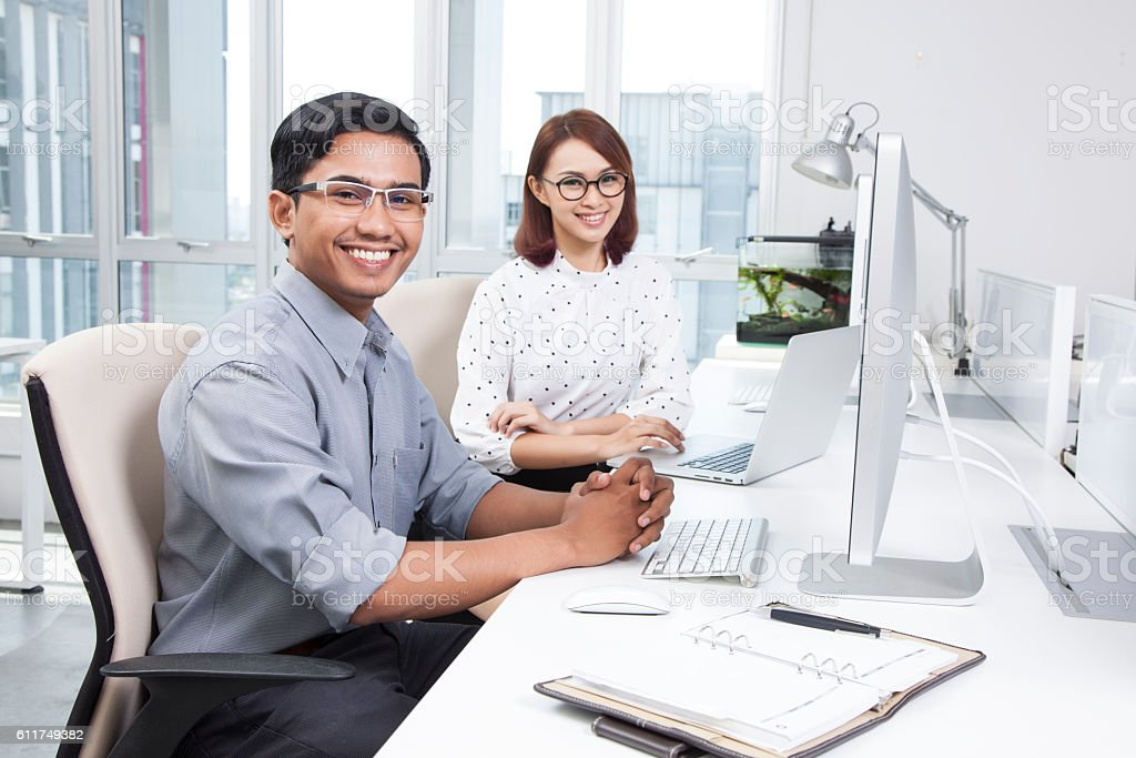Portrait of two smiling office workers stock photo