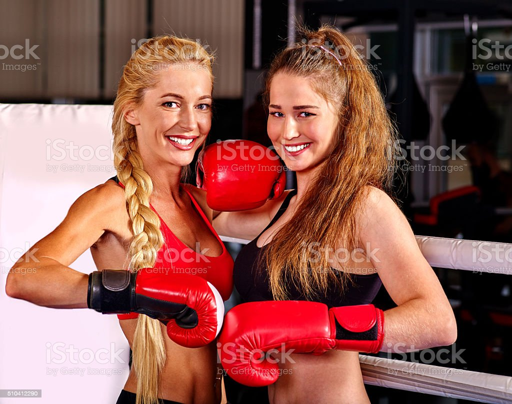 Portrait of two sport girl boxing on ring stock photo