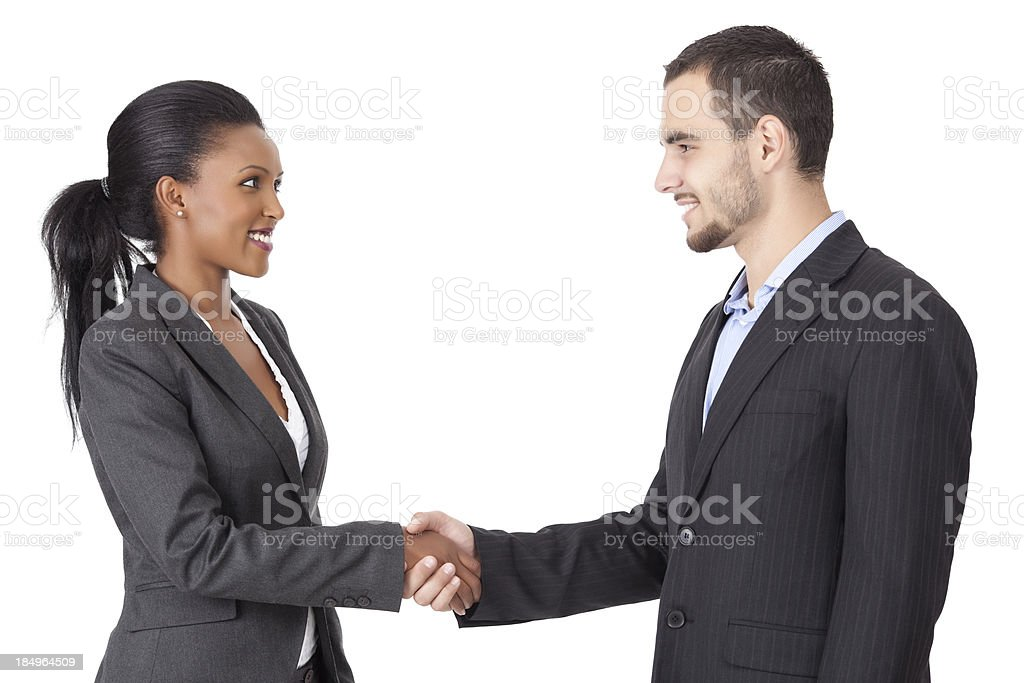 Portrait of two successful partners handshaking after closing a stock photo
