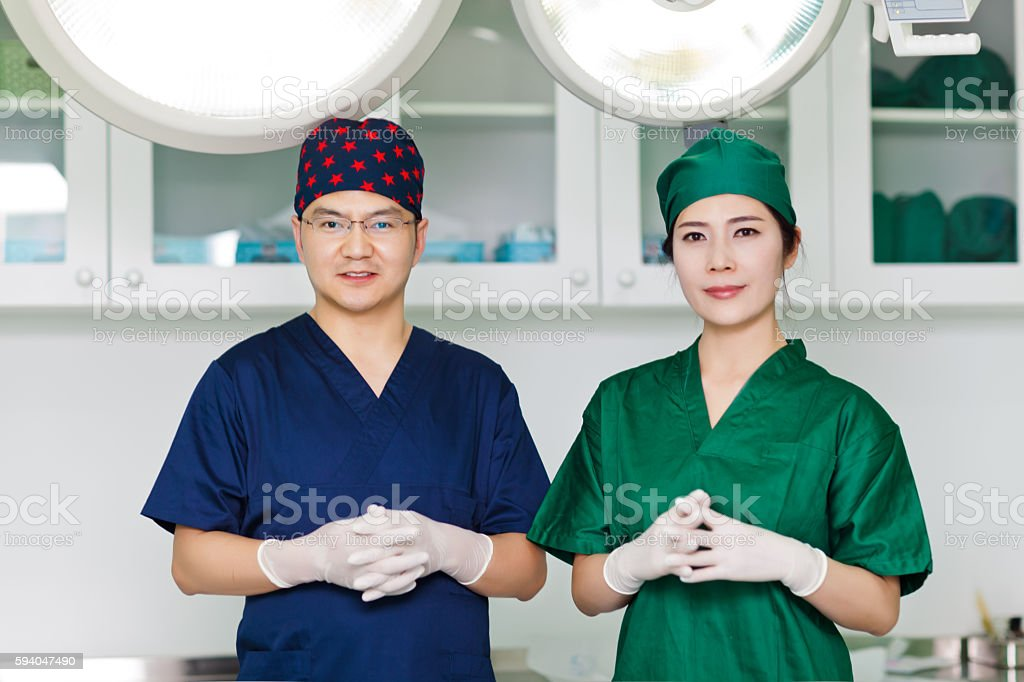 Portrait of two surgeon in an operating room stock photo