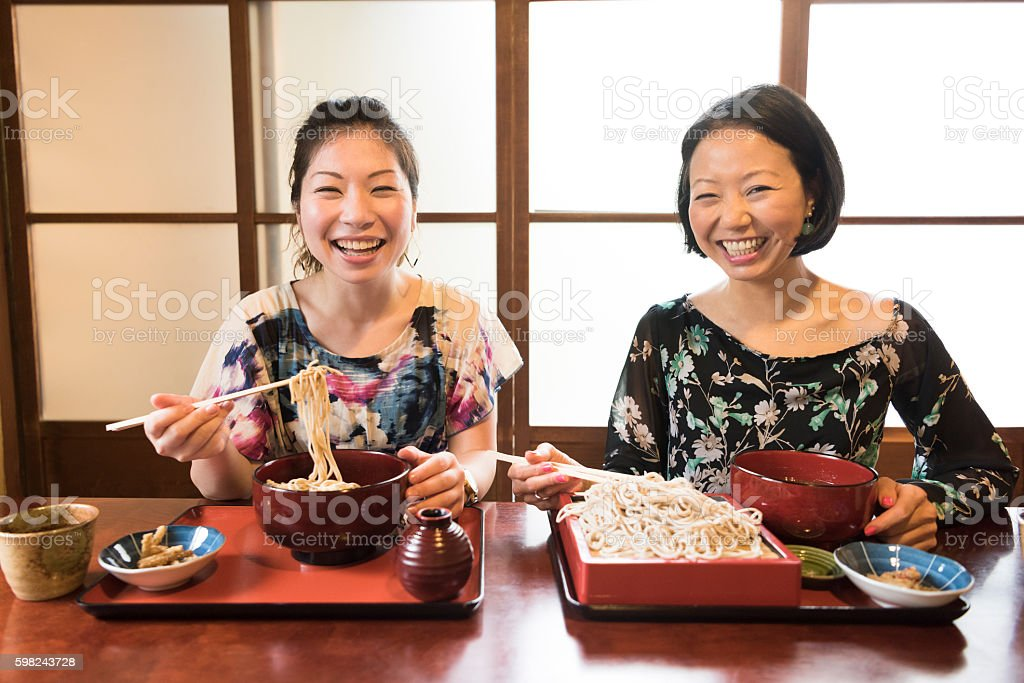 Portrait of two women smiling in Japanese restaurant stock photo