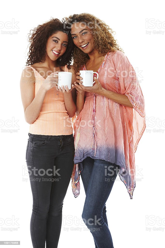 Portrait of two young females drinking coffee. royalty-free stock photo