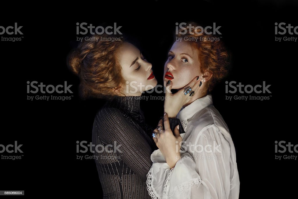 Portrait of two  Young girls fashion models gothic style stock photo
