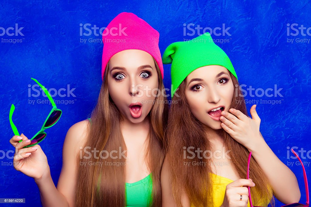 Portrait of two young pretty shocked women with open mouth stock photo