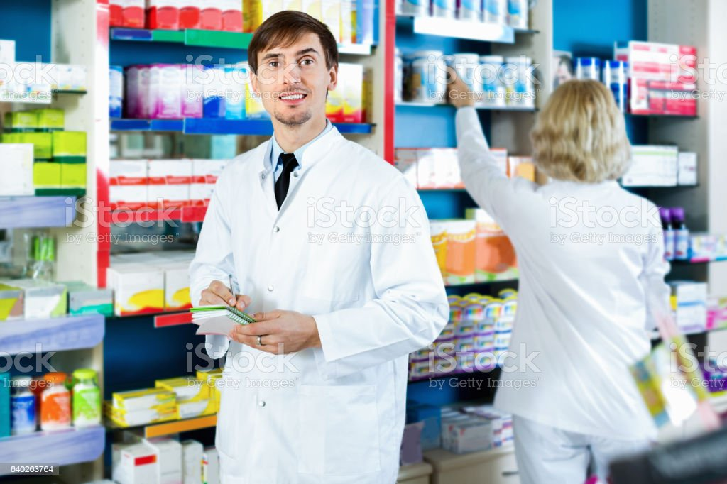 Portrait of twopharmacists working in modern farmacy stock photo