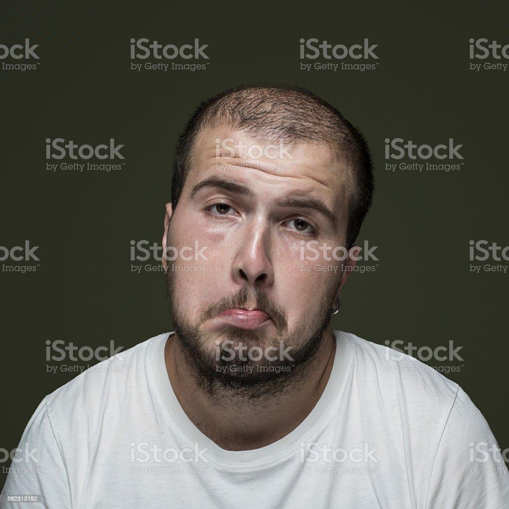 Portrait of uncertain man stock photo