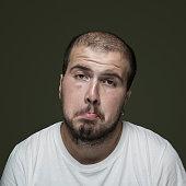 Portrait of uncertain man