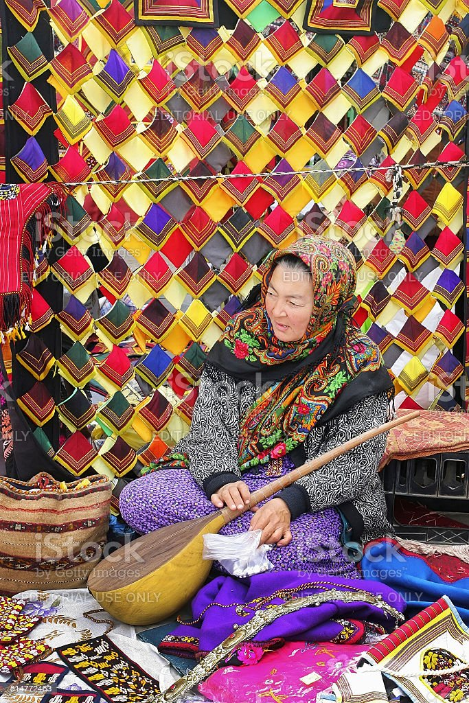 Portrait of unidentified  Asian woman with dutar. stock photo