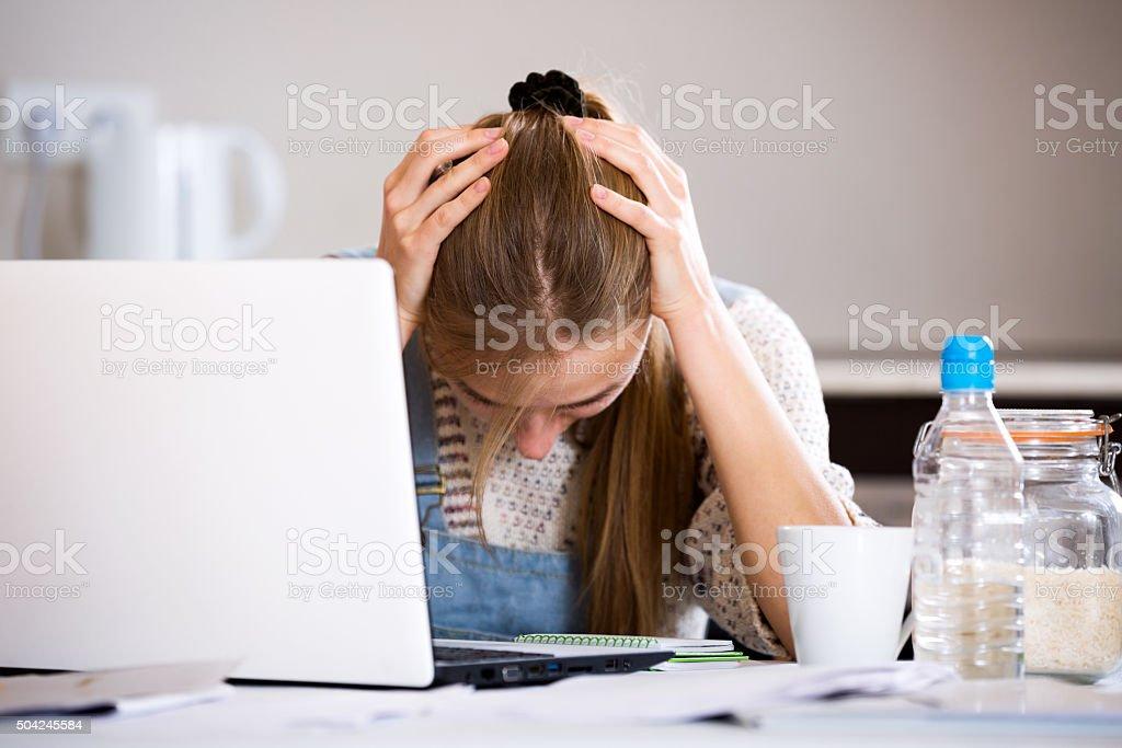 Portrait of upset girl with laptop stock photo