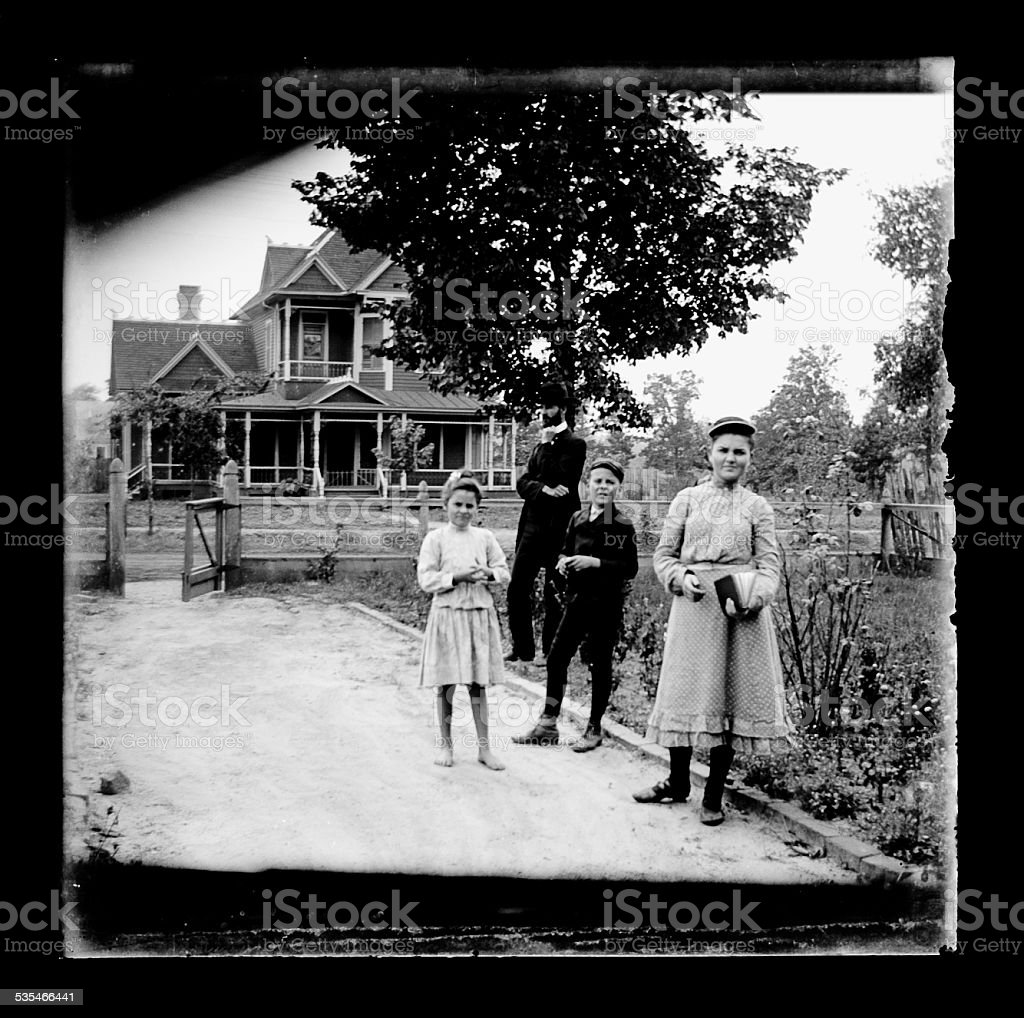 Portrait of Victorian-era family with dad looking angry. stock photo