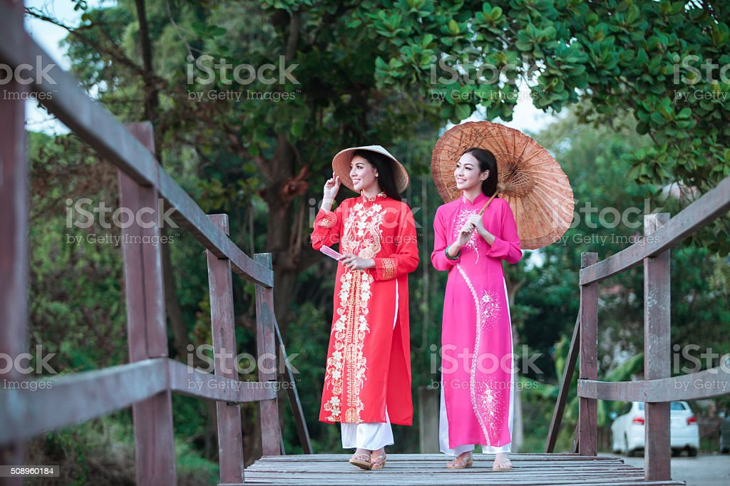 Portrait of Vietnamese girl traditional dress stock photo