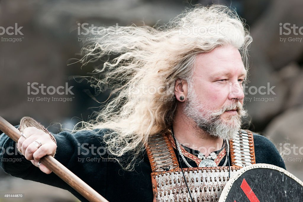 Portrait of Viking man with long hair stock photo